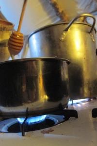 Honey-sweetened hot chocolate, on the propane stove