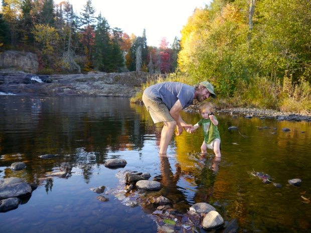 Papa and Waylon, catching rocks in the river