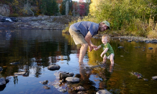 Waylon, throwing rocks in the river
